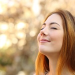 Beautiful Woman Doing Breath Exercises With An Autumn Background